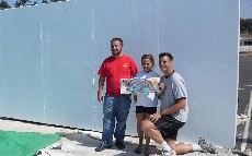Eagle Scout Evan Works with Mr. Gruenewald and Maggie on the Handball wall